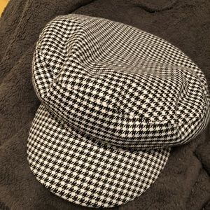 Houndstooth print train conductor hat